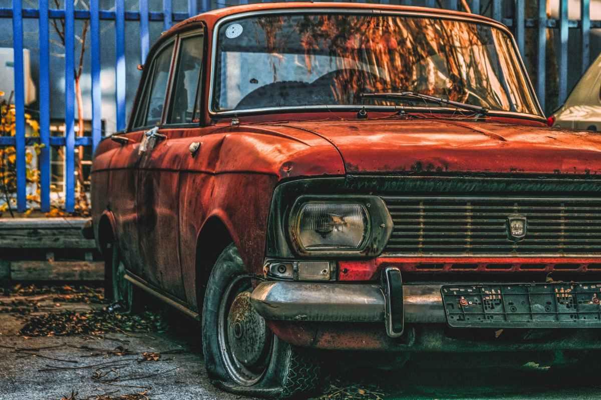 abandoned orange sedan